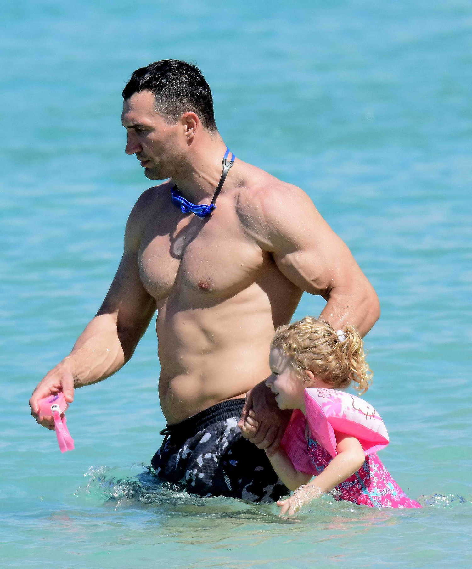 Wladimir Klitschko with Daughter on the Beach in Barbados