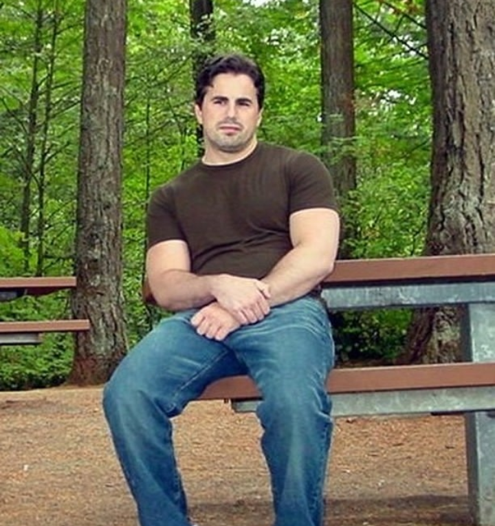 Tom Fitton sitting in the woods