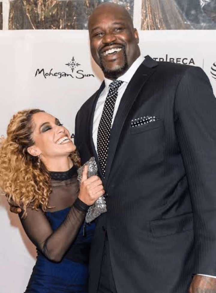 Leticia Rolle laughing with Shaquille O'Neal on a red carpet