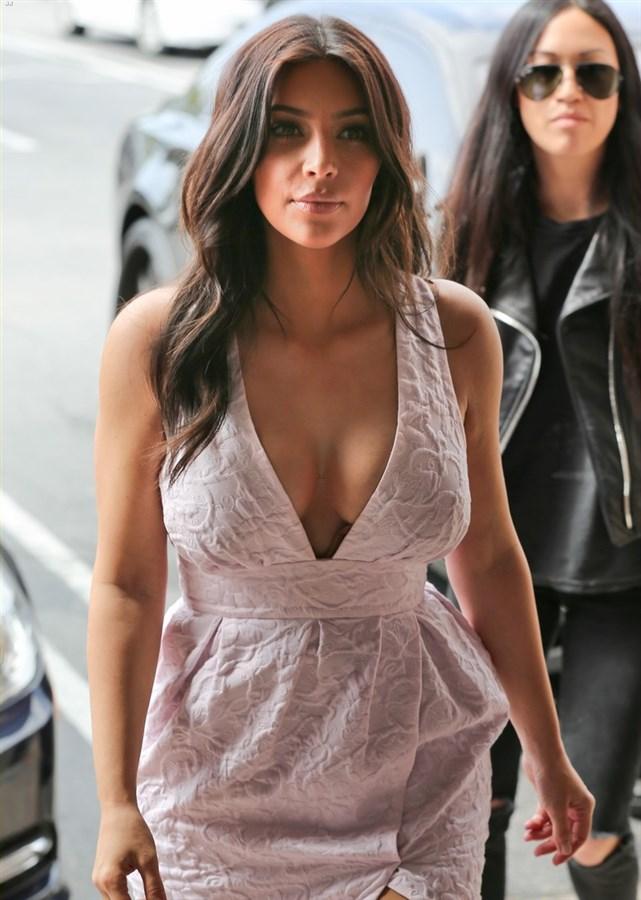 Kim Kardashian Makes Obscene Gesture While Showing Cleavage