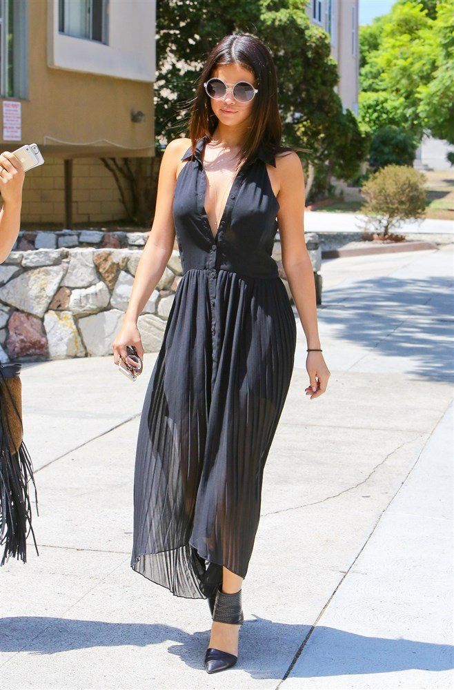 Selena Gomez Attends A Funeral In A Low Cut Dress And No Bra