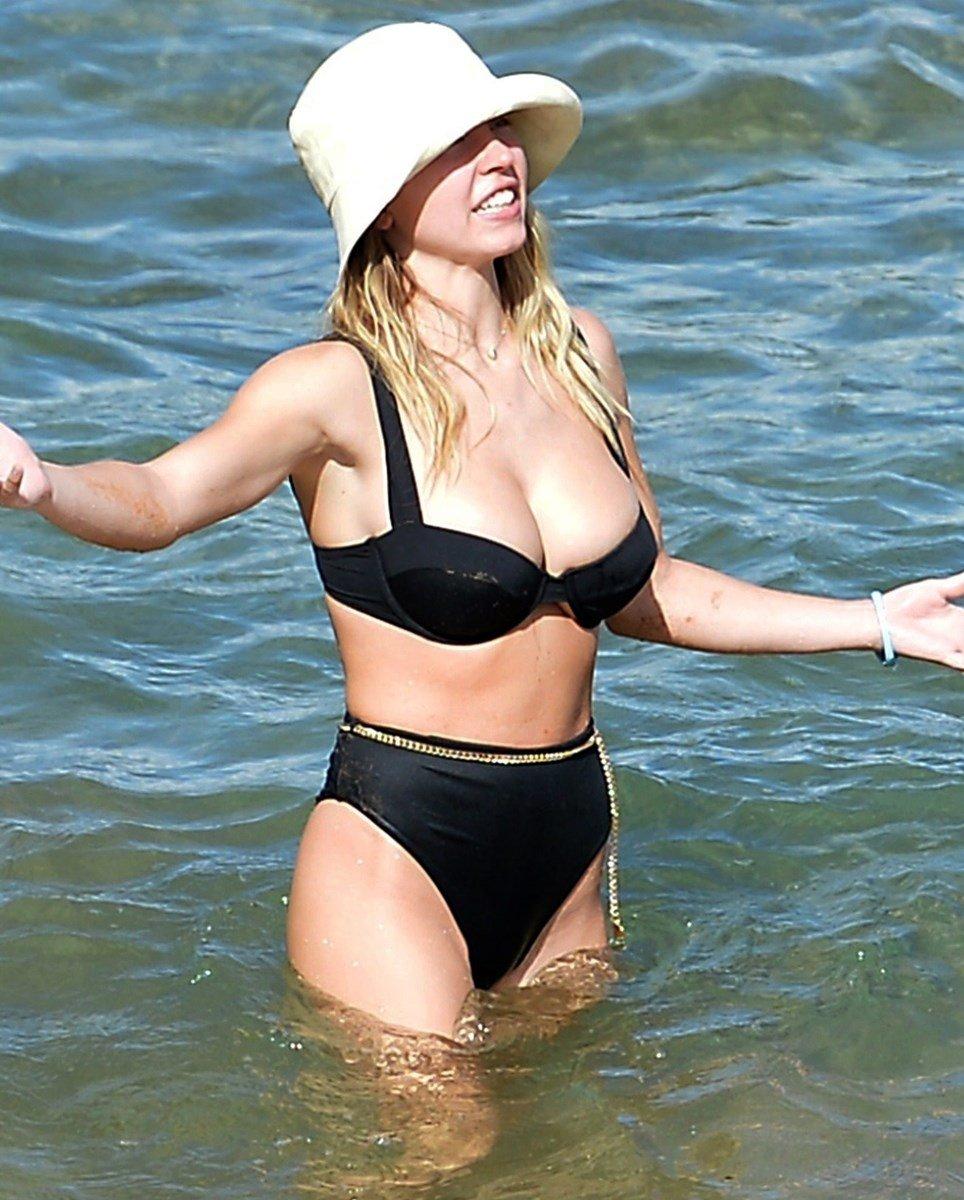 Sydney Sweeney Serves Up Her Bountiful Breasts In A Bikini