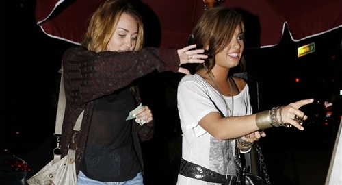 Miley Cyrus And Demi Lovato Munch Sandwiches