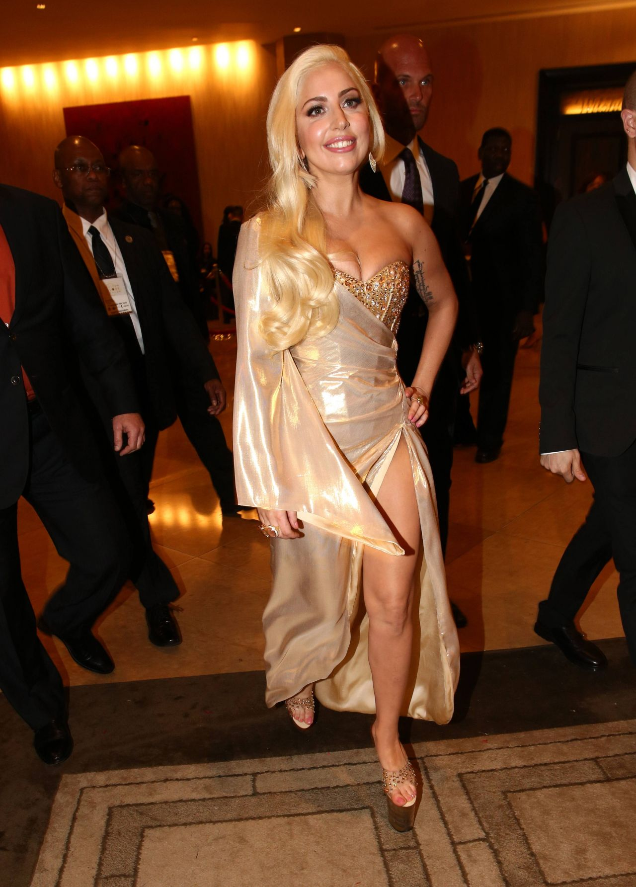 Lady Gaga Wears Perry Meek Bespoke Gold Dress at 2014