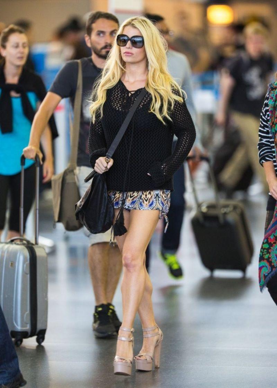 Jessica Simpson In Mini Skirt At LAX Amp JFK Airport June 2014