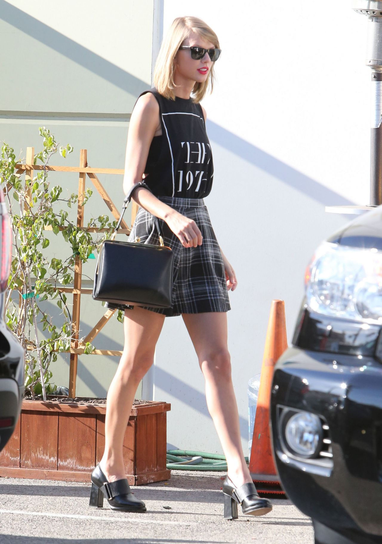 Taylor Swift Leggy in Mini Skirt  Leaving a Studio in Los Angeles  November 2014