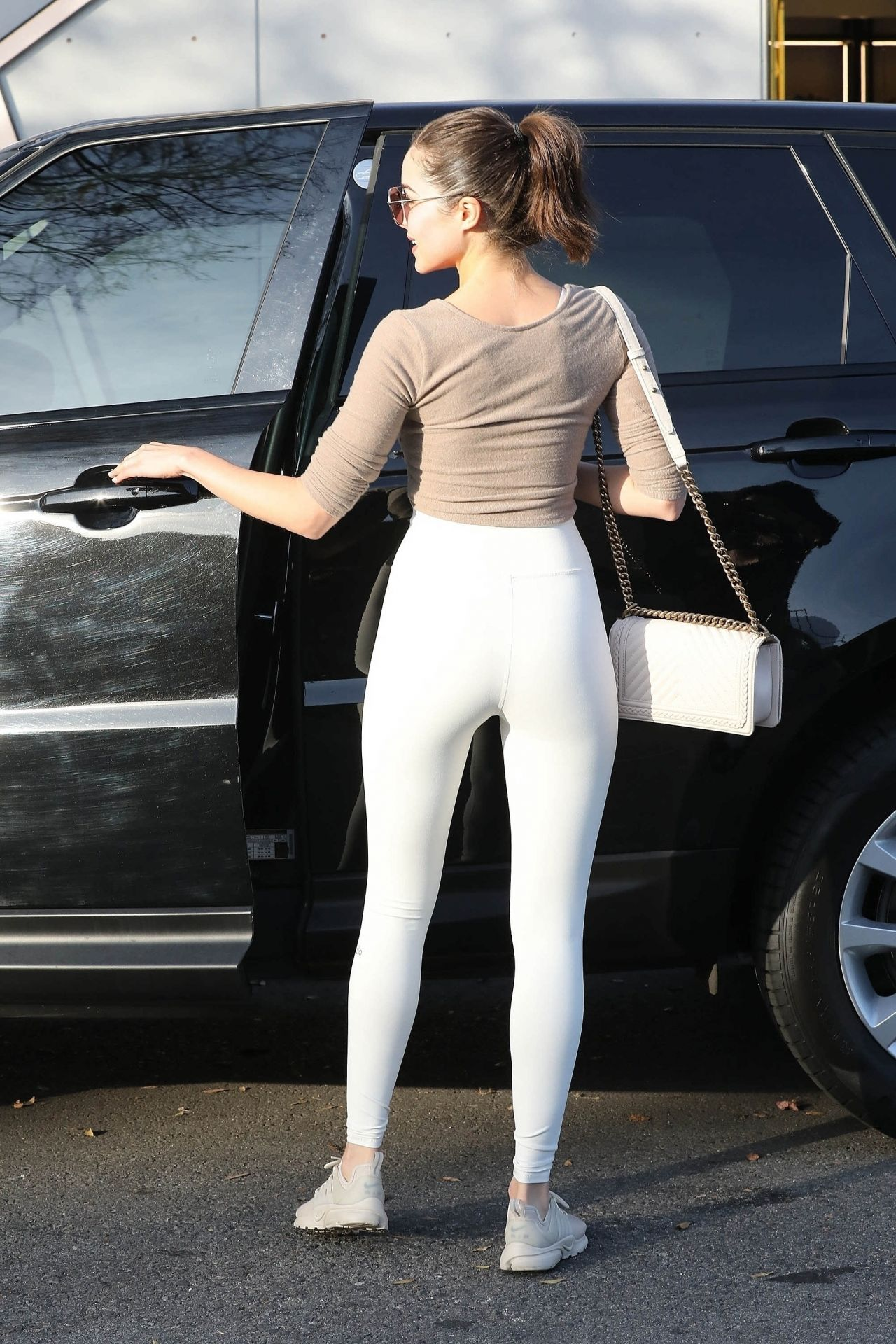 Olivia Culpo in a Small Top and Skin Tight Leggings  West