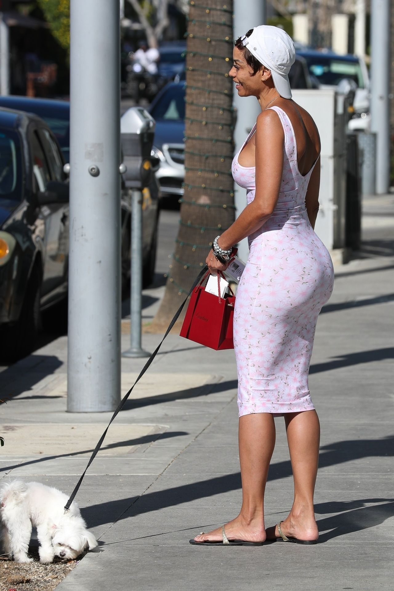 Nicole Murphy in a Form Fitting Pink Dress  Shopping in Beverly Hills 03282018
