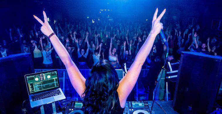 Charlotte DJing on stage