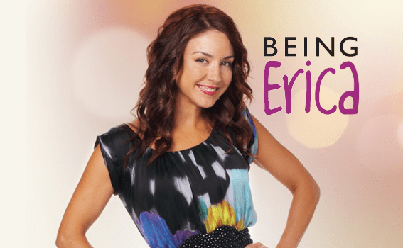 """Erin Karpluk acting as Erica Strange wearing a dark coloured dress with bright patches, with a light background and the words of the TV series, """"Being Erica"""" to the right of her."""