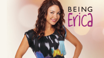 "Erin Karpluk acting as Erica Strange wearing a dark coloured dress with bright patches, with a light background and the words of the TV series, ""Being Erica"" to the right of her."