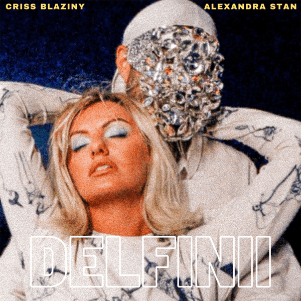 "Single artwork for ""Delfinii"" with Alexandra Stan wearing white, leaning back with her arms wrapped around Criss Blaziny's shoulders who is also wearing white with a diamante facial mask."