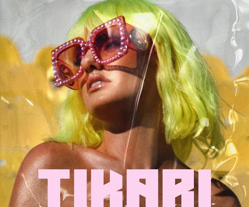 "Single artwork for ""Tikari"" which sees Alexandra Stan wearing a lemon green wig cut into a shoulder-length bob paired with Gucci pink glasses with plastic yellow seats behind her."