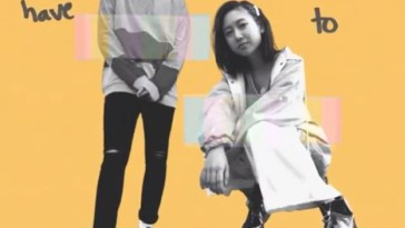 "Yellow image displaying some of the lyrics from ""Change"" with Troy Ogletree standing in the middle and ÊMIA is crouching."