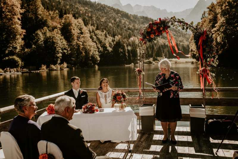 Celebrant on a raft in a lake with a Wedding Couple