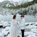 Winter scene with couple having a wedding ceremony in the snow in front of a frozen lake in Germany