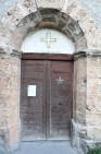 Church door with mass times posted