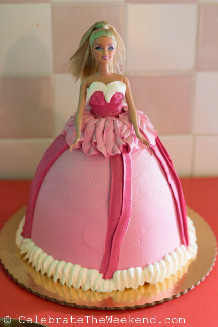 This Barbie cake is made for sharing. The birthday girl also takes home the doll.