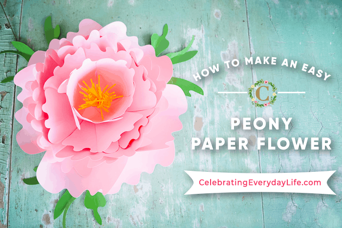 pink paper peony on a green table
