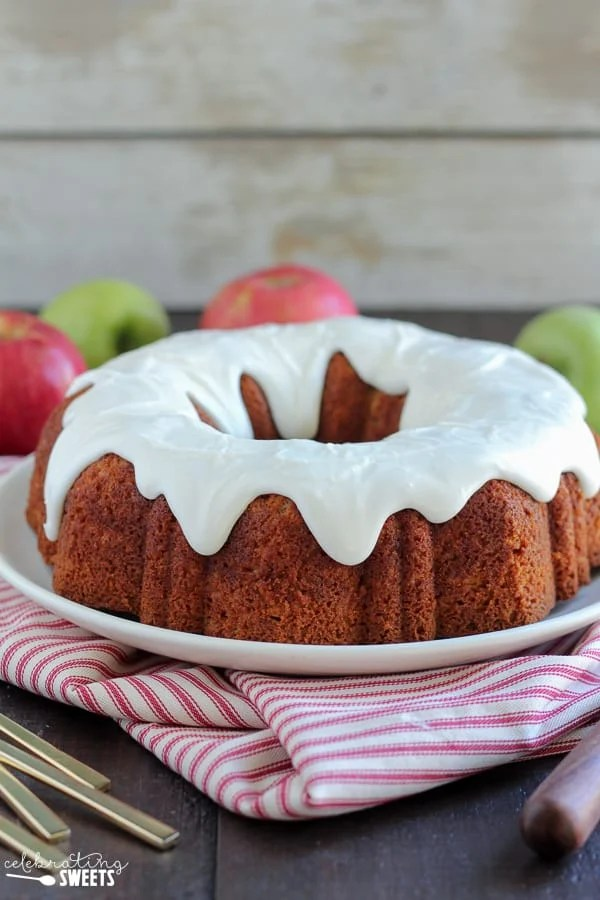 Apple Bundt Cake with Cream Cheese Frosting - A perfectly spiced, tender and moist apple bundt cake. Filled with double the apple flavor from a combination of apple butter and fresh apples. Topped with a thick cream cheese frosting this apple bundt cake is sure to be a favorite!
