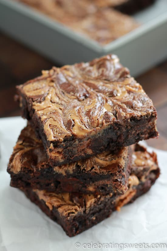 Rich, fudgy brownies filled with peanut butter cups and topped with a peanut butter swirl