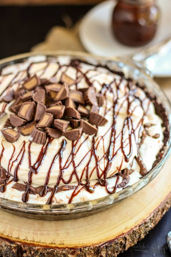 Peanut Butter Fudge Ice Cream Pie- An easy, no-bake ice cream pie loaded with peanut butter ice cream, peanut butter whipped cream, hot fudge, and peanut butter cups