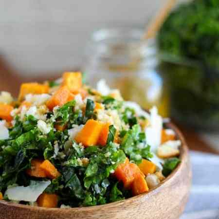Shredded kale, roasted sweet potatoes, crushed croutons, and shaved parmesan cheese dressed in a lemon-garlic vinaigrette. A healthy and delicious fall and winter meal or side dish.