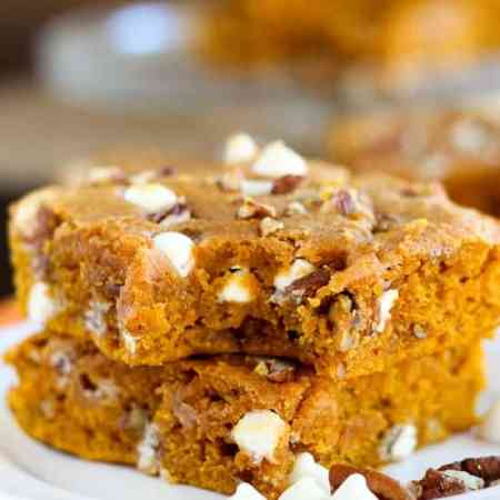 Pumpkin Blondies - Soft and moist pumpkin blondies made with brown butter and warm spices, and filled with white chocolate chips and pecans.