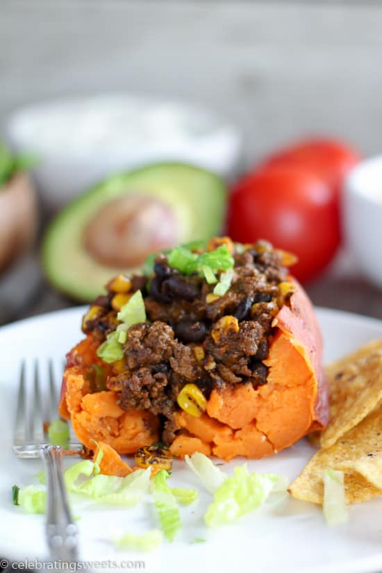 Tender baked potatoes stuffed with a filling of seasoned ground beef, black beans, and corn. Top with your favorite taco toppings!