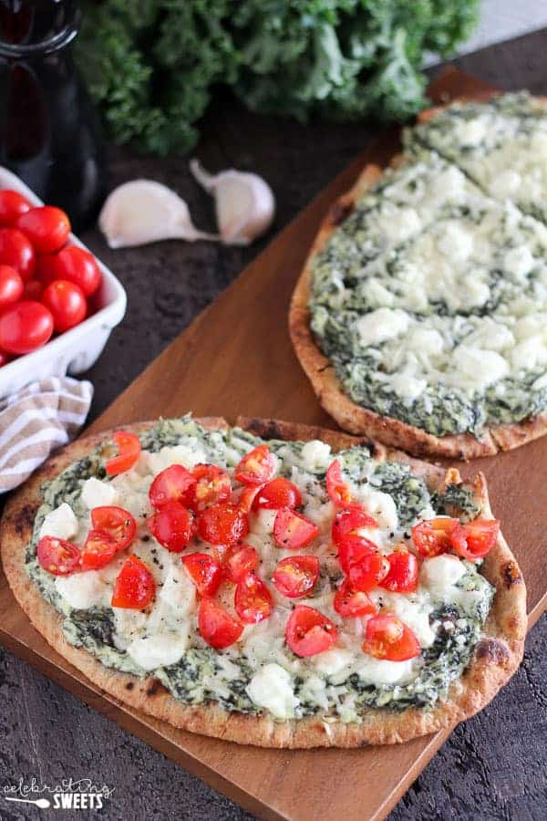 Kale and Goat Cheese Flatbread - Naan flatbread covered with creamy kale and goat cheese and topped with fresh tomatoes. This easy main dish or side dish is ready in under 30 minutes.