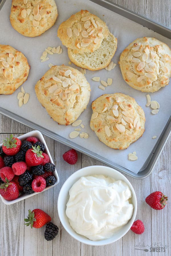 Almond Berry Shortcake - Tender almond shortcakes filled with fresh berries and almond scented whipped cream. These shortcakes are flaky and tender with a delicate almond flavor.