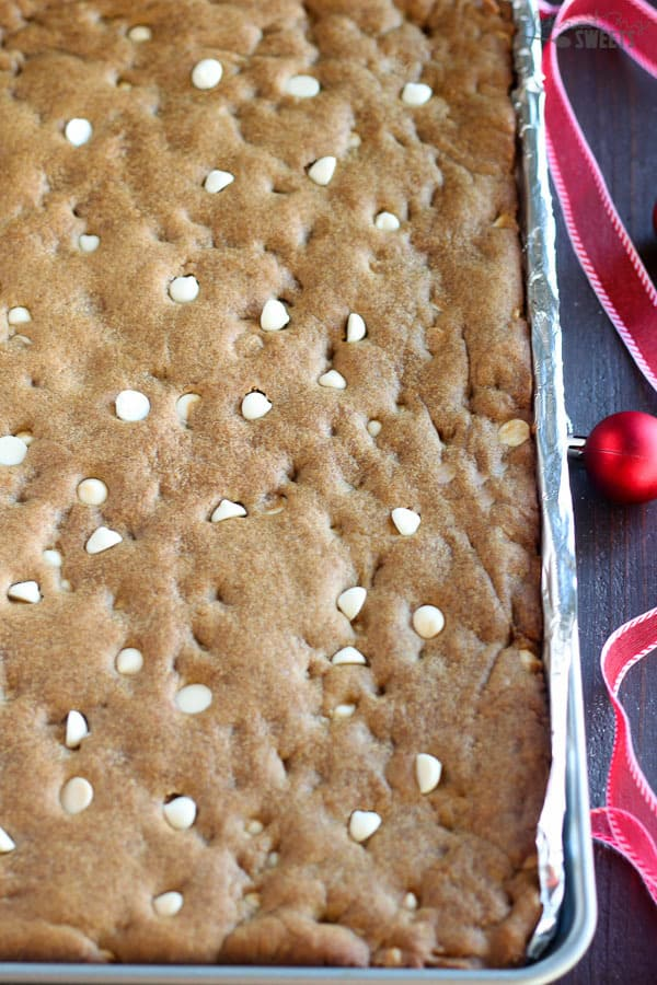 Gingerbread Cookie Bars with White Chocolate Chips - Soft and chewy spiced gingerbread cookie bars filled with white chocolate chips.