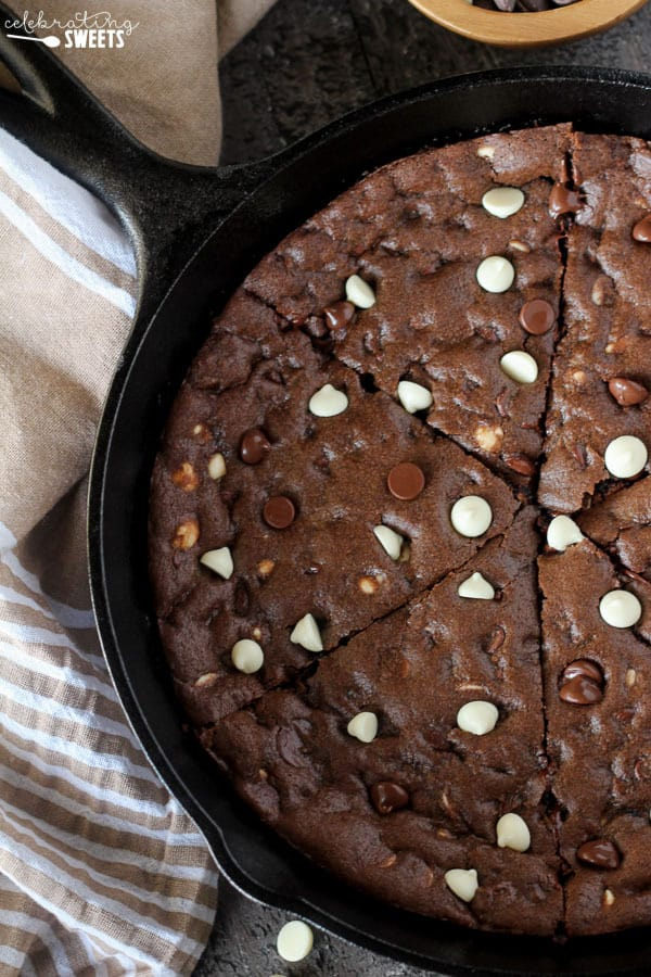 Triple Chocolate Skillet Cookie - An easy deep dish chocolate skillet cookie that is loaded with semisweet and white chocolate chips. Crisp edges, a gooey- fudgy center and chocolate in every single bite!