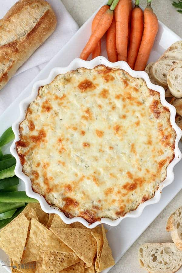 Creamy warm Artichoke Dip filled with three cheeses. An easy crowd-pleasing appetizer.