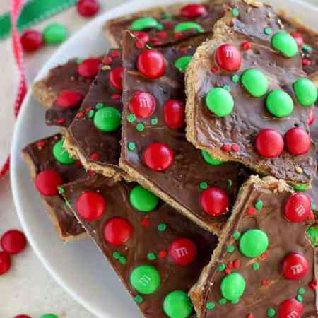 This festive Christmas Bark is easy and delicious! Layers of graham crackers, brown sugar toffee, peanut butter, and chocolate make this an addictive holiday treat.