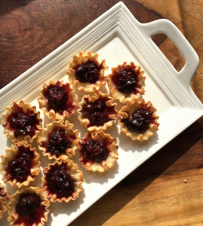 Dark Cherry and Brie Phyllo Cups Recipe - a perfect appetizer for holiday gatherings! You can also use homemade cranberry sauce in place of the dark cherries.