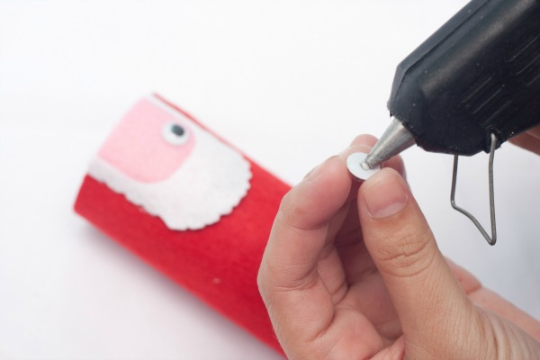 Make a cute Santa from a toilet paper roll and felt. Step 10