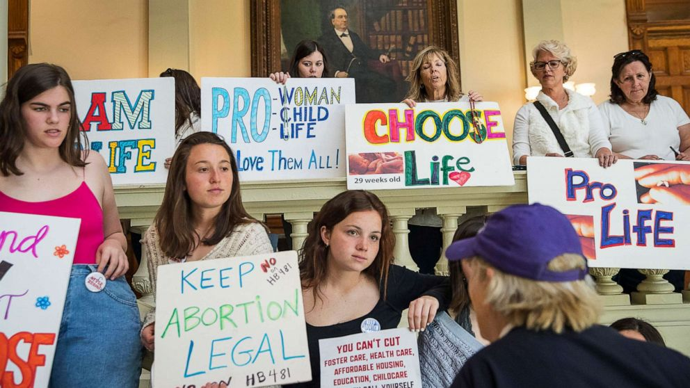 Georgia governor signs controversial ban on abortion after ...
