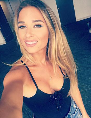 Jessie James Decker Instagram: Motel Tampico Lace Up Bodysuit, Denim cut off shorts and Sol Sana suede sandals (August 2016)