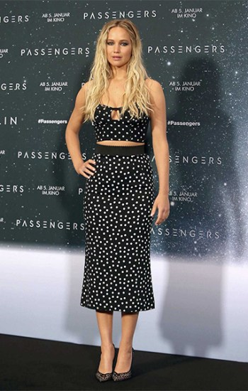 Jennifer Lawrence in Dolce & Gabbana Black & White Polka Dot Bustier and Christian Louboutin Neoalto Lace & Suede Pumps at 'Passengers' Berlin Photocall — December 2, 2016