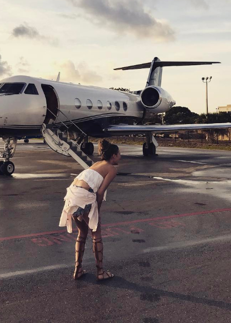 Chrissy Teigen in Rails Mara Striped Just Peachy Shirt (Instagram January 4, 2017)