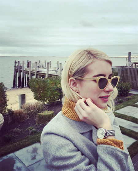 Emma Roberts in COACH watch and Lovers + Friends Alexa Sweater in Marigold (Instagram December 16, 2016)