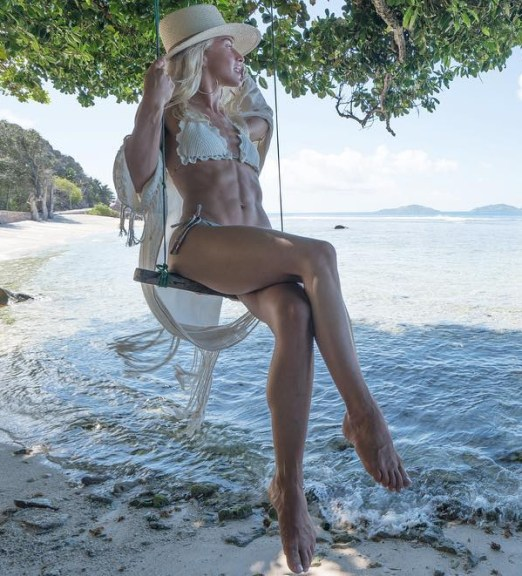 Julianne Hough wears a Zimmermann 'Mercer' crocheted triangle bikini in honeymoon Instagram shot, July 17, 2017.