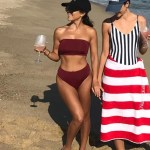 Kourtney Kardashian in the Myra Swim Daria Bikini Top in Wine and the matching Mia Bikini Bottoms in Wine on the beach in Nantucktet (Instagram pic, July 18, 2017.)