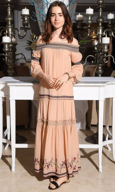 Lily Collins promotes her new Netflix drama To The Bone at the Ischia Film Festival (July 14), wearing a Rachel Zoe Cassidee Off-the-shoulder Embroidered Silk-chiffon Dress in Antique Rose.