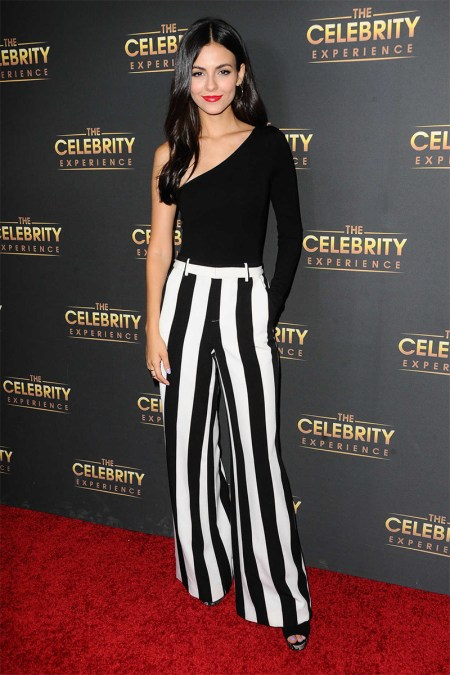 Victoria Justice attends The Celebrity Experience on July 16, 2017 in Los Angeles, CA, wearing a LPA Bodysuit 25 and Alice + Olivia Paulette Striped Wide-Leg Pants.