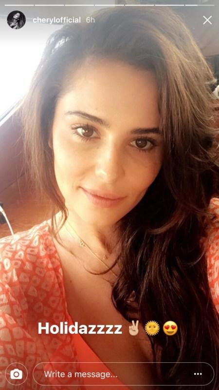 "Cheryl wears a Cloe Cassandro Jemima printed silk-chiffon wrap dress on her Instagram Story captioned ""Holidazzzz"" (Aug 27, 2017)."