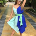 Eva Longoria strikes a happy pose in this shot posted to her Instagram (July 18) while in Marbella, Spain. She is wearing a Diane von Furstenberg sleeveless scarf dress in Aqua Klein Blue, a Melissa Odabash fedora hat and Dior Origin sunglasses in Cold/Copper. The sunglasses are also available in two other shades.