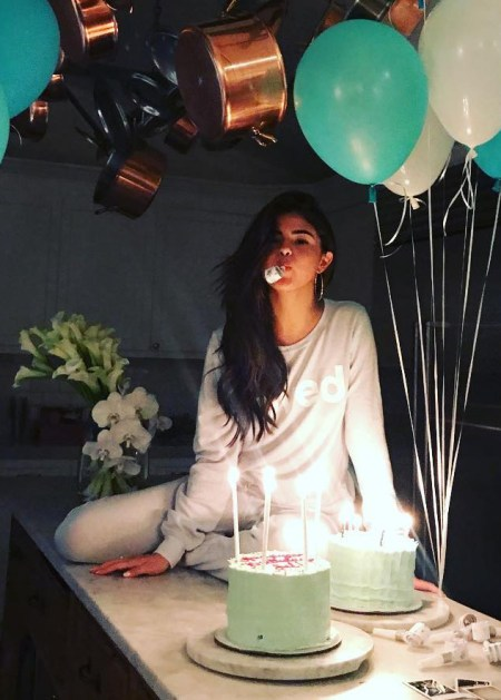 Selena Gomez celebrates her 25th birthday with balloons, cake and a cozy pajamas, taking to Instagram (July 23, 2017) to thank her fans for their birthday wishes. Her pajama top is a Dream Scene Loved Graphic Sweatshirt.