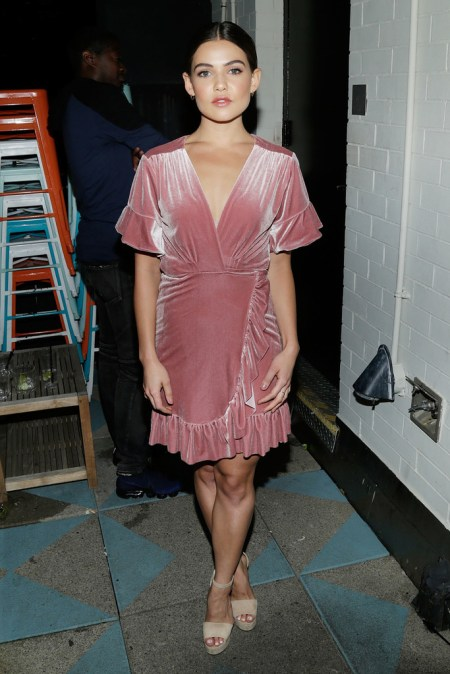 """Danielle Campbell attends the Flaunt and Reebok """"The Eternal Issue"""" celebration, wearing a shimmering pink velvet wrap dress by Misa Los Angeles, featuring a braided belt with short flared sleeves, on September 8, 2017 in NYC."""
